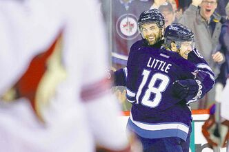 Jets' Bryan Little and Andrew Ladd celebrate Little's second-period goal against the Arizona visitors.