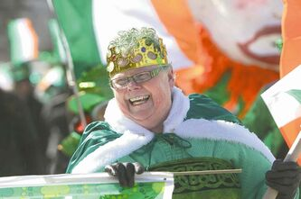 Catriona Younger, crowned the Celtic Queen, beams as she heads up the St. Patrick�s Day parade Saturday. (Ruth Bonneville / Winnipeg Free Press)