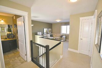 A 15.6-foot by 12.6-foot family room/loft is found on the upper level to the left of the stairs.