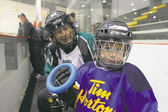 Eighty-six-year-old Alda Tait and three-year-old Kiera Pattie took part in Wednesday's opening ceremony at the Western Canadian Ringette Championships.