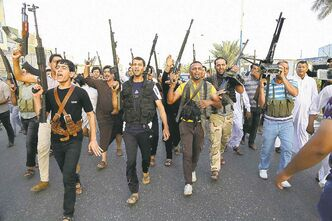 Iraqi Shiite tribal fighters chant slogans against the al-Qaida-inspired Islamic State of Iraq and the Levant.