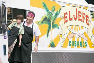 Emjay Anthony and Jon Favreau in Chef.