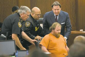 Ronald Lee Haskell is helped after he collapsed in a Houston courtroom Friday.
