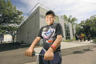 Dylan Broten, 10, outside the new Mayfair Recreation Centre, Wednesday.