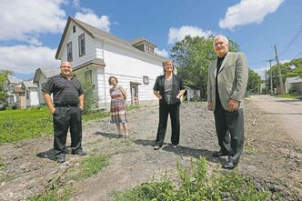 From left, Frank Zappia, Linda Ring, Lori Thorsteinson and Peter Squire at 441 Arlington Street, the site of the next HOP built home.
