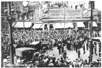 Crowds gather at Portage and Main during the fight for worker rights in the 1919 Winnipeg General Strike.