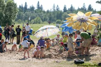 Kids play in the sun during the Winnipeg Folk Festival.