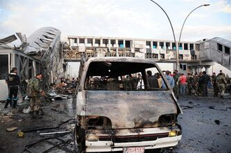 In this photo released by the Syrian official news agency SANA, Syrian government soldiers and citizens gather at a bus station which was attacked by a suicide car bomb, in the town of Sumariyah, southwest of Damascus, Syria, Tuesday Nov. 26, 2013. Several people were killed and wounded, Syrian state TV said. (AP Photo/SANA)