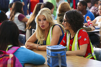 Graynor, left, and Gilbert bond in the school cafeteria.
