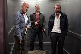 FILE - This publicity film image released by 20th Century Fox shows Bruce Willis as John McClane, left, Jai Courtney as his son Jack, center and Sebastian Koch as Komarov in a scene from