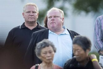 Toronto Mayor Rob Ford, centre, stands with his brother councillor Doug Ford as he attends a Conservative Party BBQ in Toronto on August 29, 2013. Canada's two largest newspapers acted responsibly and in the public interest in reporting on drug allegations against Mayor Rob Ford and his brother, Coun. Doug Ford, the Ontario Press Council ruled Wednesday. THE CANADIAN PRESS/Chris Young
