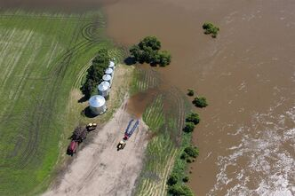 The swollen Assiniboine River covers farmland near Brandon, Man. on Sunday, July 6, 2014. THE CANADIAN PRESS/Tim Smith