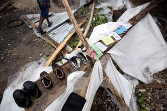 Personal items are set out to dry as homeowners cull through the debris of their homes destroyed by Hurricane Matthew in Les Cayes, Haiti, Thursday, Oct. 6, 2016. Two days after the storm rampaged across the country