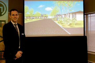 Fahr Group vice-president of operations Johnathan Fahr is shown by a virtual tour of his company's proposed East St. Paul development.