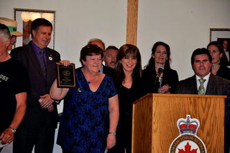 Darcy Robert receives her Good Neighbour Award on May 31