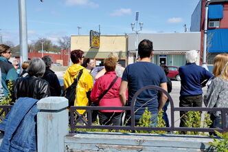 Participants in the Transcona Historical Museum's 2012 Jane's Walk listen to tour guide Alanna Horejda.