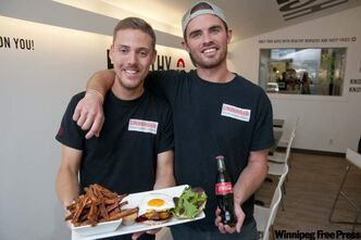Unburger owners Marc Priestly, left, and Kyle Matheson with the Drunken Aussie burger, sweet yam fries and chipotle dip.