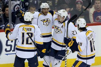 Predators Mike Fisher (left), Seth Jones, Patric Hornqvist and Michael Del Zotto celebrate Jones' first-period goal against the Jets at the MTS Centre Tuesday night.