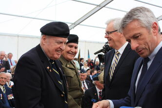 Stan Butterworth (left) receives a medal at the Juno Beach Centre near Caen, Normandy,  in France as Premier Greg Selinger (second from right) looks on.