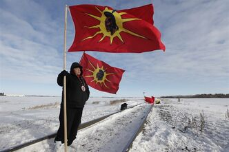 Idle No More demonstrators block a CN east-west track just west of Portage La Prairie, Manitoba Wednesday, January 16, 2016. THE CANADIAN PRESS/John Woods