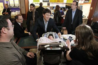 Liberal party leader Justin Trudeau poses for a photograph with Lillian, one month, for proud parents Jennifer and Chris Myers in a food court in downtown Winnipeg, Thursday, May 2, 2013. THE CANADIAN PRESS/John Woods