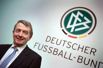 The new President of the German soccer Federation Wolfgang Niersbach poses for the media after he was elected as the successor of Theo Zwanziger in Frankfurt, central Germany, Friday, March 2, 2012. Niersbach, a former football journalist, becomes the DFB's 11th president. He has joined the federation in 1988, one year after taking charge of the media for the organization committee of the 1988 European Championship, held in Germany. (AP Photo/dapd, Thomas Lohnes)