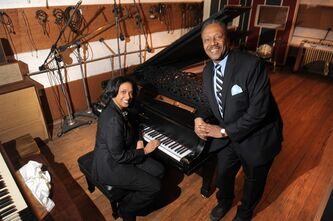 Robin R. Terry, left, Chairman of the Board of Trustees of Motown Museum, and Interim Motown Museum CEO Allen Rawls pose for a photo with the prized Steinway grand piano, Monday, April 1, 2013. The 1877 Steinway grand piano used by Motown greats during the label's 1960s heyday, and restored thanks to Paul McCartney, is back home in Detroit. (AP Photo/The Detroit News, Max Ortiz)