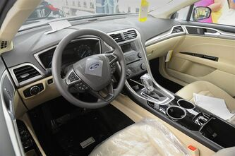 The interior of a new 2014 Ford Fusion is displayed in Flatrock, Mich. on Thursday, Aug. 29, 2013. For the first time, Ford is making its Fusion sedan in the U.S. The company's Flat Rock, Mich., plant began making the Fusion on Thursday. (AP Photo/Detroit News, Charles V. Tines)