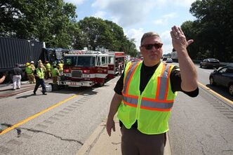 Kalamazoo County Kalamazoo County Sheriff Richard Fuller directs traffic in the eastbound lanes of I-94 to keep moving as emergency responders work to remove the bus driver from a Greyhound bus that collided with a semi-truck, Thursday, Aug. 1, 2013 on westbound Interstate 94 near Galesburg, Mich. Authorities say a Chicago-bound Greyhound bus hit the back of a semi-truck in southwestern Michigan, leaving 11 people with what were described as minor injuries. (AP Photo/Kalamazoo Gazette-MLive Media Group, ) ALL LOCAL TV OUT; LOCAL TV INTERNET OUT