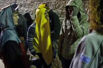 Kyle Robinson of Grand Rapids, left, Juan Pena of Grand Rapids, center, and Dave Florshinger of New Era, Mich., wait in line at Best Buy in Norton Shores ten minutes before its Black Friday opening on Thursday, Nov. 22, 2012. in Muskegon, Mich. (AP Photo/The Chronicle-mlive.com, Libby March)