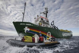 This image made available by environmental organization Greenpeace shows the Greenpeace ship Arctic Sunrise entering the Northern Sea Route (NSR) off Russia's coastline to protest against Arctic oil drilling, Saturday, Aug. 24, 2013. The sign reads