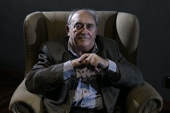 Denis Goldberg, a friend and prisoner with former South African President Nelson Mandela, attends an event of the 50th anniversary of the raid against him and other former African National Congress leaders at the Liliesleaf Farm in the outskirts of Johannesburg, South Africa, Monday, July 8, 2013. Mandela remains in a critical condition in a hospital in Pretoria. (AP Photo/Markus Schreiber)