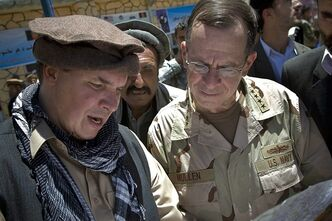 "FILE - In this July 15, 2009 file photo released by Department of Defense, author Greg Mortenson shows the locations of future village schools to U.S. Navy Adm. Mike Mullen, at the opening of Pushghar Village Girls School 60 miles north of Kabul in Panjshir Valley, Afghanistan. Philadelphia Indemnity Insurance Co., will pay $1.2 million to a charity co-founded by ""Three Cups of Tea"" author Greg Mortenson in a settlement over the legal costs of a lawsuit and an investigation into Mortenson and the Central Asia Institute, attorneys involved in the settlement said Thursday Nov. 7, 2013. The settlement still must be approved by U.S. District Judge Dana Christensen. The judge has given the sides until Dec. 6 to file dismissal papers. (AP Photo/Department of Defense, U.S. Navy Petty Officer 1st Class Chad J. McNeeley, File)"