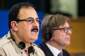 FILE - In this Wednesday March 6, 2013 file photo, Chief of Staff of the Free Syrian Army Gen. Salim Idris addresses the media after he discussed the situation in Syria with the leader of the Group of the Alliance of Liberals and Democrats for Europe Guy Verhofstadt, right, at the European Parliament in Brussels. Idris marked the second anniversary of the start of the uprising against President Bashar Assad on Friday, March 15, 2013, by pledging to fight until the