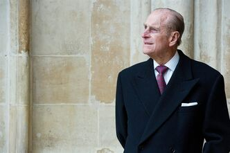 FILE - In a March 14, 2011 file photo, Britain's Prince Phillip looks at the assembled choir following the annual Commonwealth Day Observance Service at Westminster Abbey in London. Prince Philip celebrated his 90th birthday Friday, June 10, 2011 in apparent good health and good humor but announced plans to cut back his officials duties. (AP Photo/Leon Neal, pool, File)
