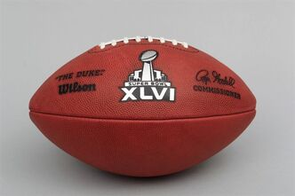 FILE - This Jan. 24, 2012 file photo shows the official football for the NFL Super Bowl XLVI, in Cleveland. Kids ROFL and OMG all the livelong day, but ask them to decipher the XLVI of this year's Super Bowl and you might as well be talking Greek. Roman numerals beyond the basics have largely gone the way of cursive and penmanship as a subject in the nation's schools. The New England Patriots will play the New York Giants in the Super Bowl on Feb. 5 in Indianapolis. (AP Photo/Tony Dejak, File)