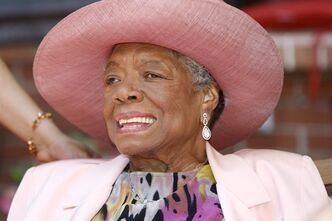 "FILE - In this May 20, 2010, file photo, author Maya Angelou socializes during a garden party at her home in Winston-Salem, N.C. The National Book Foundation announced Thursday, Sept. 5, 2013, that Angelou, author of ""I Know Why the Caged Bird Sings,"" will be this year's recipient of the Literarian Award, an honorary National Book Award for contributions to the literary community. (AP Photo/Nell Redmond, File)"