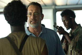 This film image released by Sony - Columbia Pictures shows Tom Hanks, center, in a scene from