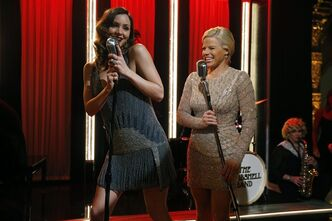 This Dec. 12, 2012 photo released by NBC shows Katharine McPhee, left, and Megan Hilty on the set of