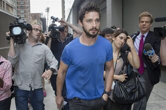 "FILE - This June 27, 2014 file photo shows actor Shia LaBeouf walks through the media after leaving Midtown Community Court following his arrest the previous day for yelling obscenities at the Broadway show ""Cabaret,"" in New York. LaBeouf and Alec Baldwin never ended up sharing a Broadway stage as planned last year, but real-life dramatics landed both of them Thursday, July 24, in a distinctly less celebrated venue: Manhattan courts. Both stars appeared in crowded downtown courtrooms, a few blocks apart, in separate disorderly conduct cases: LaBeouf charged with allegedly disrupting a Broadway performance, and Baldwin accused of getting belligerent with police who said they stopped him for riding a bicycle the wrong way down a one-way street. (AP Photo/John Minchillo, File)"