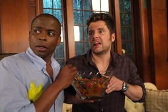 "This publicity image released by USA Network shows Dule Hill as Gus Guster, left, and James Roday as Shawn Spencer in a scene from the 100th episode of ""Psych,"" airing Wednesday, March 27 on USA. The network plans to let viewers of ""Psych"" choose the ending of Wednesday's episode, both a celebration of the drama's 100th episode and culmination of a two-year experiment at an exclusively fan-centered approach at marketing. (AP Photo/USA Network, Alan Zenuk)"