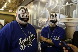 FILE - This Jan. 8, 2014 file photo shows Joseph Bruce aka Violent J, left, and Joseph Utsler aka Shaggy 2 Dope, members of the Insane Clown Posse after a news conference in Detroit. The federal government can't be blamed for any fallout from a 2011 FBI report that put a gang tag on fans of the music group Insane Clown Posse, a judge said. U.S. District Judge Robert Cleland dismissed a lawsuit by the rap-metal duo and fans, known as Juggalos, who said they've been targeted by police because they have jewelry or tattoos with the group's symbol, a man running with a hatchet. Cleland said the U.S. Justice Department is not responsible for how authorities use a national report on gangs. (AP Photo/Carlos Osorio, File)