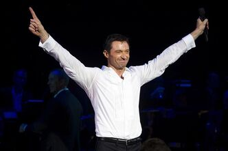 "Hugh Jackman appears onstage at the curtain call for the opening night performance of ""Hugh Jackman, Back on Broadway"", in New York."