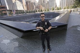 A heavily armed Port Authority police officer stand guard next to the North Pool at the World Trade Center memorial site Friday, Sept. 9, 2011 in New York. Just days before the 10th anniversary of the Sept. 11 attacks, U.S. counterterrorism officials are chasing a credible but unconfirmed al-Qaida threat to use a car bomb on bridges or tunnels in New York City or Washington. (AP Photo/Mary Altaffer)
