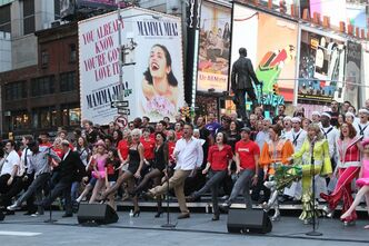 "Broadway performers sing ""New York, New York"" to commemorate the 10th anniversary of the Sept. 11 attacks, Friday Sept. 9, 2011 in New York's Duffy Square. The mini-concert was a replay of what the Broadway community sang 10 years ago to promote theater in New York City following 9/11. (AP Photo/Tina Fineberg)"