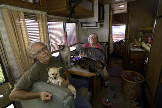Walker and Mooney along with eight cats are squeezed into a 30-foot motorhome with the family Chihuahua to wait for their first cross-country trip.