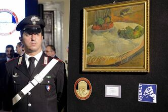 A carabiniere (Italian paramilitary police) officer stands by a Paul Gauguin still life recovered by authorities, during a press conference in Rome, Wednesday, April 2, 2014.