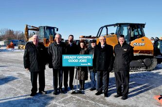 Premier Greg Selinger is joined by (L-R) Infrastructure and Transportation Minister Steve Ashton, MLA for St. Norbert Dave Gaudreau, Healthy Living and Seniors Minister Sharon Blady, and Chris Lorenc of the Manitoba Heavy Construction Association.