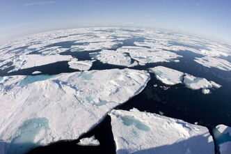 Ice floes float in Baffin Bay above the Arctic circle on July 10, 2008.