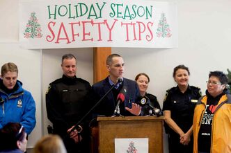 (Left to right) Kevin Chief, MLA for Point Douglas, hosted a Holiday Season Safety Tips gathering at the North Centennial Recreation & Leisure Facility on Dec. 9. Chief is seen here with members of the Winnipeg Police Service, Auxiliary Cadets and the North End's Ambassadors program.